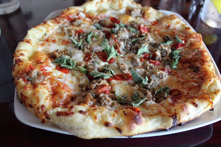 At Tribeca in Olmos Park, the House-Made Italian Sausage pizza comes with roasted red peppers and fresh oregano.
