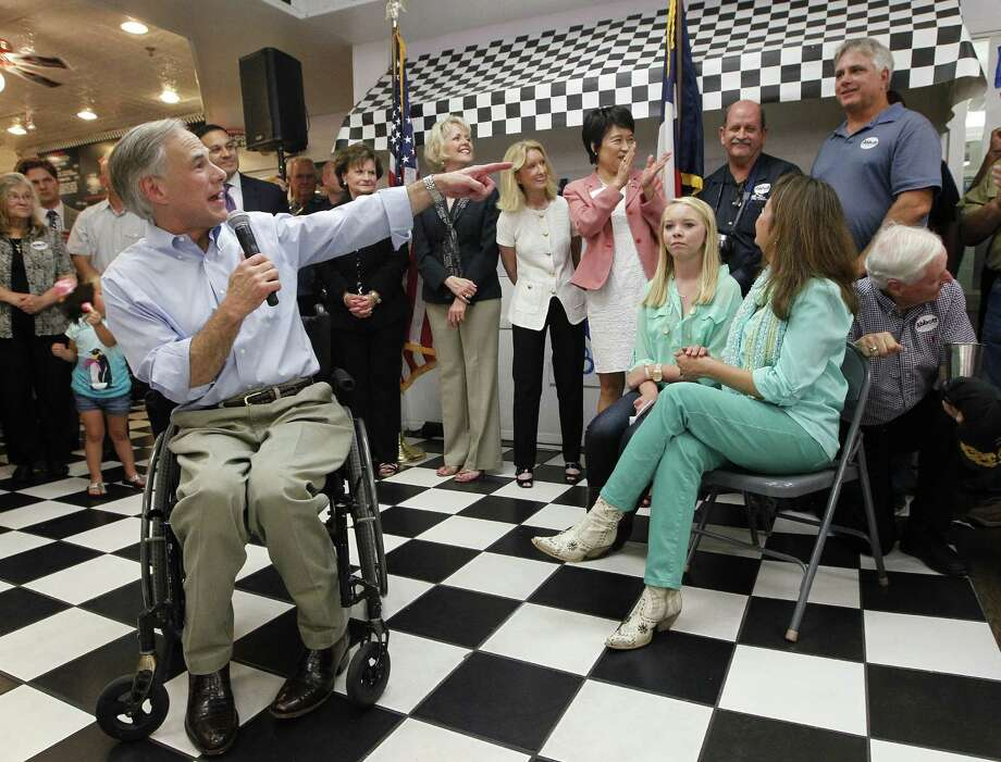 Greg Abbott, pointing out classmates during a campaign stop in Duncanville, says advocates' worries about his views are misguided. Photo: Ron T. Ennis / Associated Press