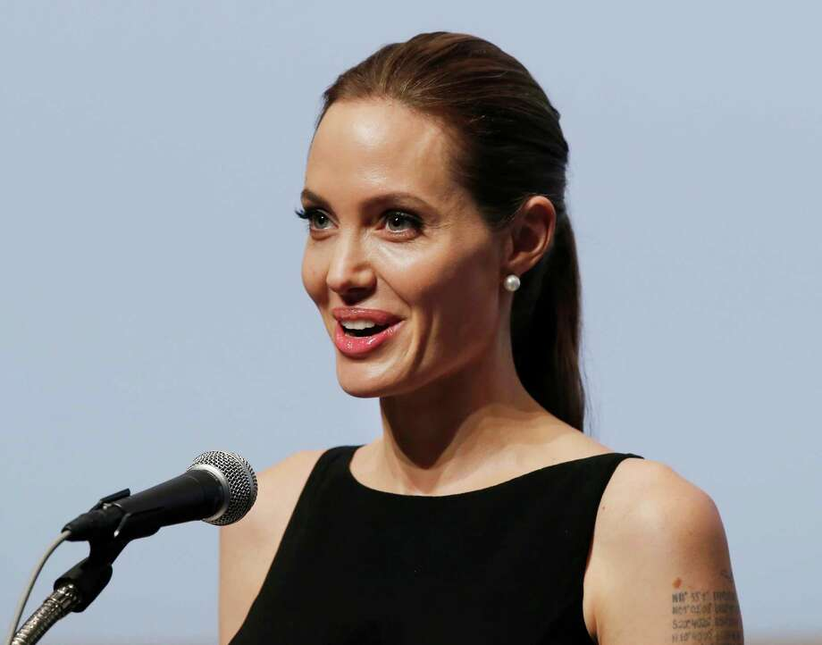 "In May, Oscar-winning actress Angelina Jolie stunned the world when she wrote about undergoing a preventive double mastectomy after genetic testing showed she was at a high risk for developing breast and ovarian cancer. The article appeared in the New York Times and her revelation, later dubbed ""the Angelina Jolie effect,"" lead to a marked increase in genetic testing at treatment centers everywhere. Jolie also shed light on the topic amid a very public disclosure she handled with courage, dignity and grace. Photo: Koji Sasahara, Associated Press / AP"