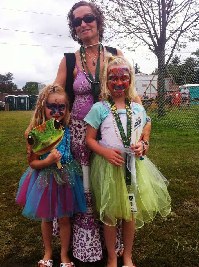"FEELS LIKE HOME Kasey-Anne Clark, 7, and her sister, Katey-Anne, 5, came to the Gathering of the Vibes Kids Tent as little girls. But they left as far out creatures. Kasey-Anne transformed into a ""rainbow kitty""; her sister, a butterfly. ""I love it here,"" said Kasey Anne, who, along with her sister, got their faces painted by volunteer artists at the Kids Tent Friday. ""I love the music,"" Katey-Anne added, her face sparkling with magenta face paint. This is the Kasey-Anne and Katey-Anne's third years at the Vibes. They were accompanied by their parents, Brackett and Carey Clark. ""It's great exposure them to be in such a culturally diverse atmosphere,"" said Clark, who has been bringing her family to the Vibes since they moved from California three years ago.  Brackett and Carey Clark started following the Grateful Dead in college, joining the tight-knit community of West Coast Dead Heads. Now, they've found the same kind of kinship at the Gathering of the Vibes.  ""At the Kids Tent, they said welcome home,"" Carey Clark said. ""It really does feel that way – every year, you feel like you're being welcomed back home."" Photo: Scott Gargan, Connecticut Post"