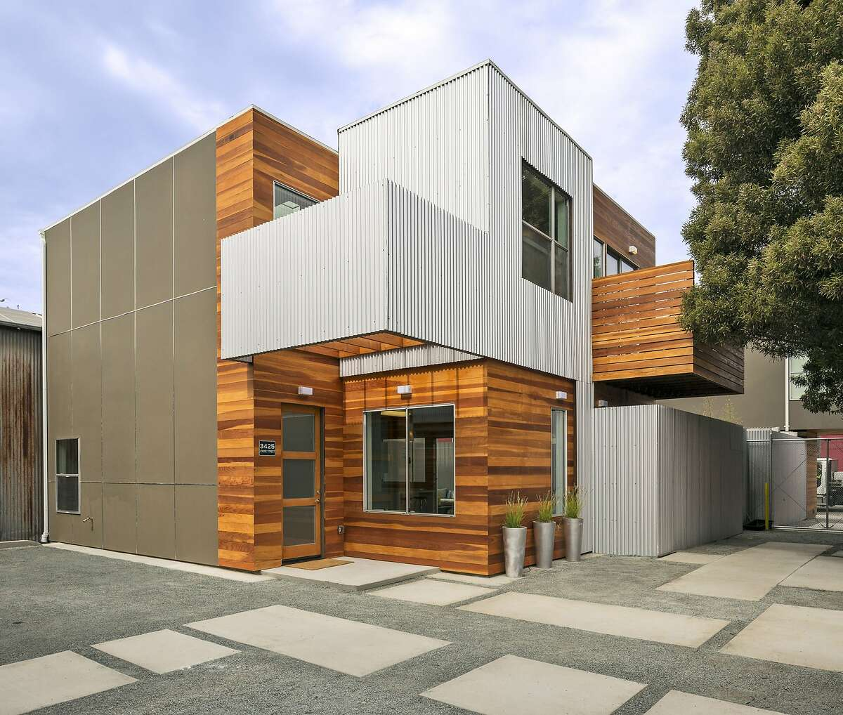 3425 Louise St. features a contemporary design highlighted by a decorative wooden facade.