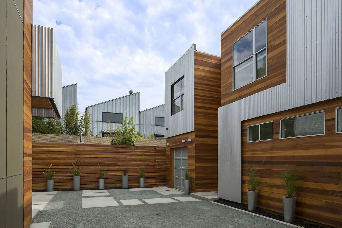 A parking area is set beside the three-bedroom Oakland home.