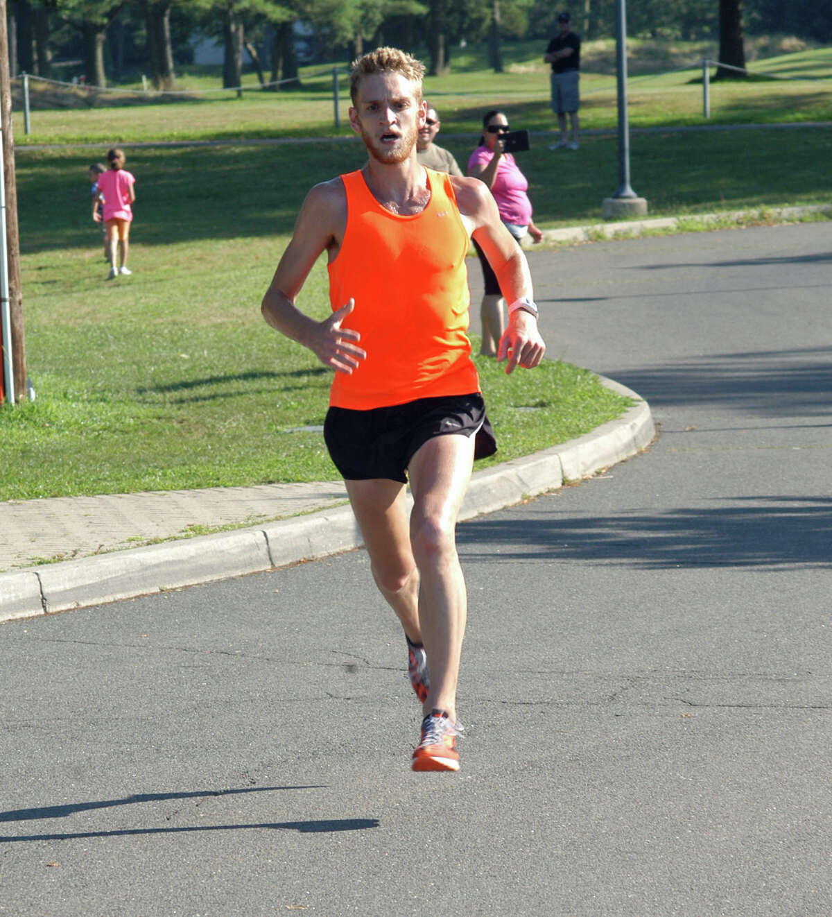 Luke McCambley, 23, of New York, races to a first-place finish at the Westport Road Runners Series 4.7-miler on Saturday. McCambley finished the course at Longshore Country Club in 25:41 for his fourth straight win.