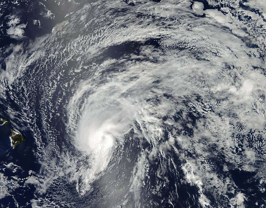 This image from NASA's Aqua satellite shows Tropical Storm Flossie nearing Hawaii. It is expected to be downgraded to a tropical depression. Photo: Jeff Schmaltz, AFP/Getty Images