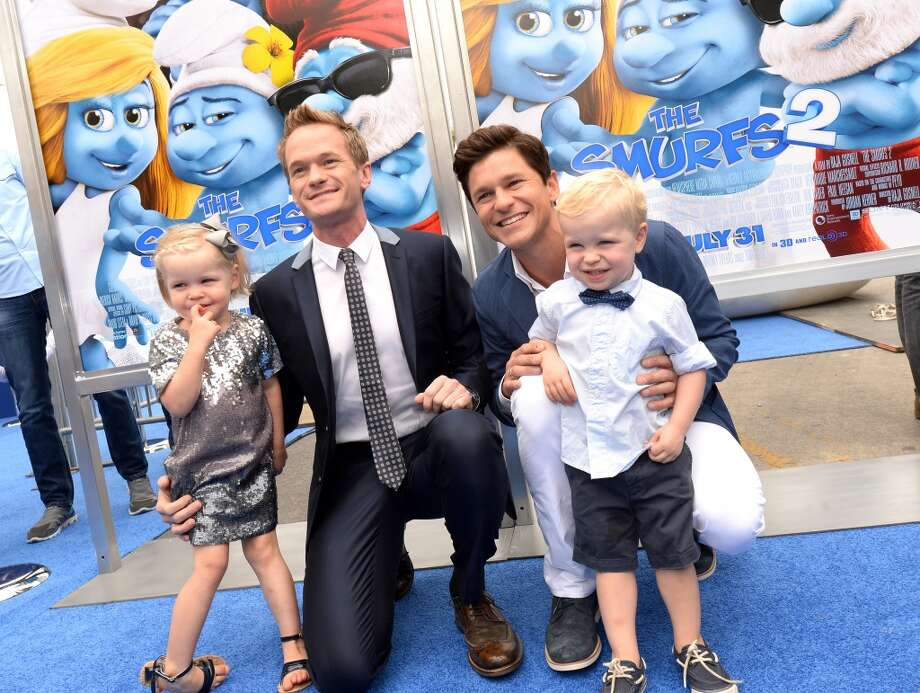 "Actor Neil Patrick Harris (2nd-L), David Burtka (2nd-R), Harper Grace Burtka-Harris (L), and Gideon Scott Burtka-Harris (R) attends the Los Angeles premiere of ""The Smurfs 2"" at Regency Village Theatre on July 28, 2013 in Westwood, California.  (Photo by Michael Buckner/Getty Images for SONY) Photo: Michael Buckner"