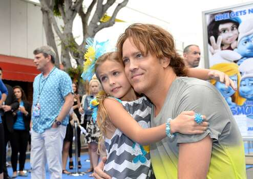 Anna Nicole Smith's daughter, Dannielynn, is shown with her father, Larry Birkhead, in Los Angeles in 2013.  (Photo by Michael Buckner/Getty Images for SONY) Photo: Michael Buckner