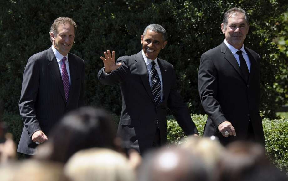 San Francisco Giants President and CEO Laurence Baer, left, President Barack Obama and Giants manager Bruce Bochy, arrive on the South Lawn of the White House. Photo: Susan Walsh, Associated Press