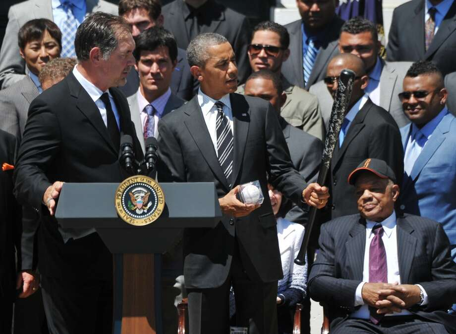 US President Barack Obama holds an autographed bat and ball presented to him by San Francisco Giants manager Bruce Bochy. Photo: MANDEL NGAN, AFP/Getty Images