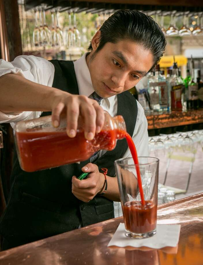 Add enough tomato juice to fill a pint glass about two-thirds full Photo: John Storey, Special To The Chronicle