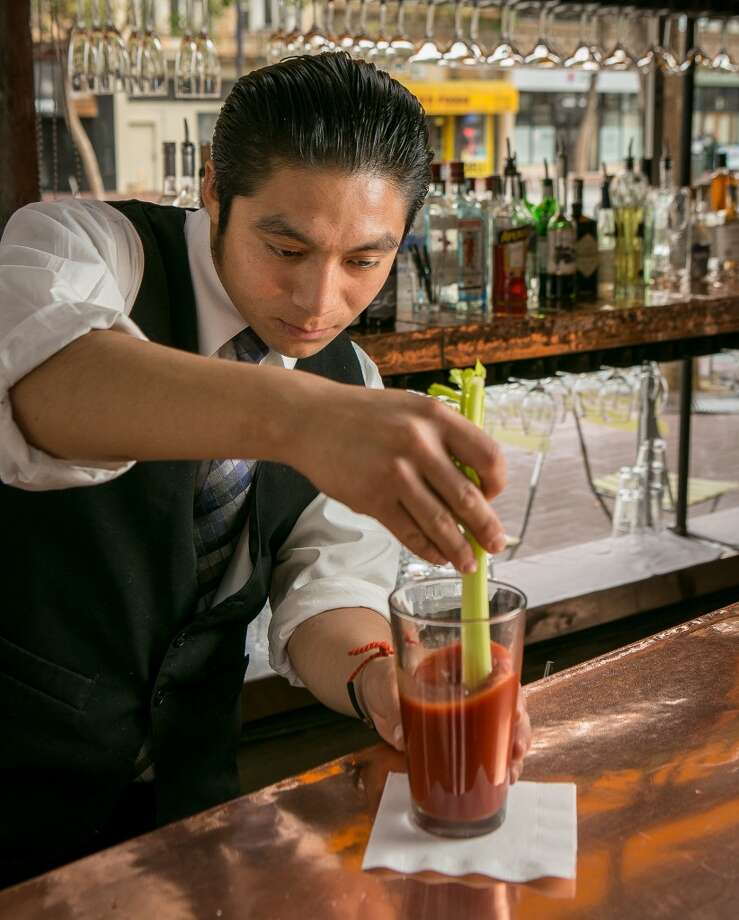Add celery stalk and stir. Photo: John Storey, Special To The Chronicle