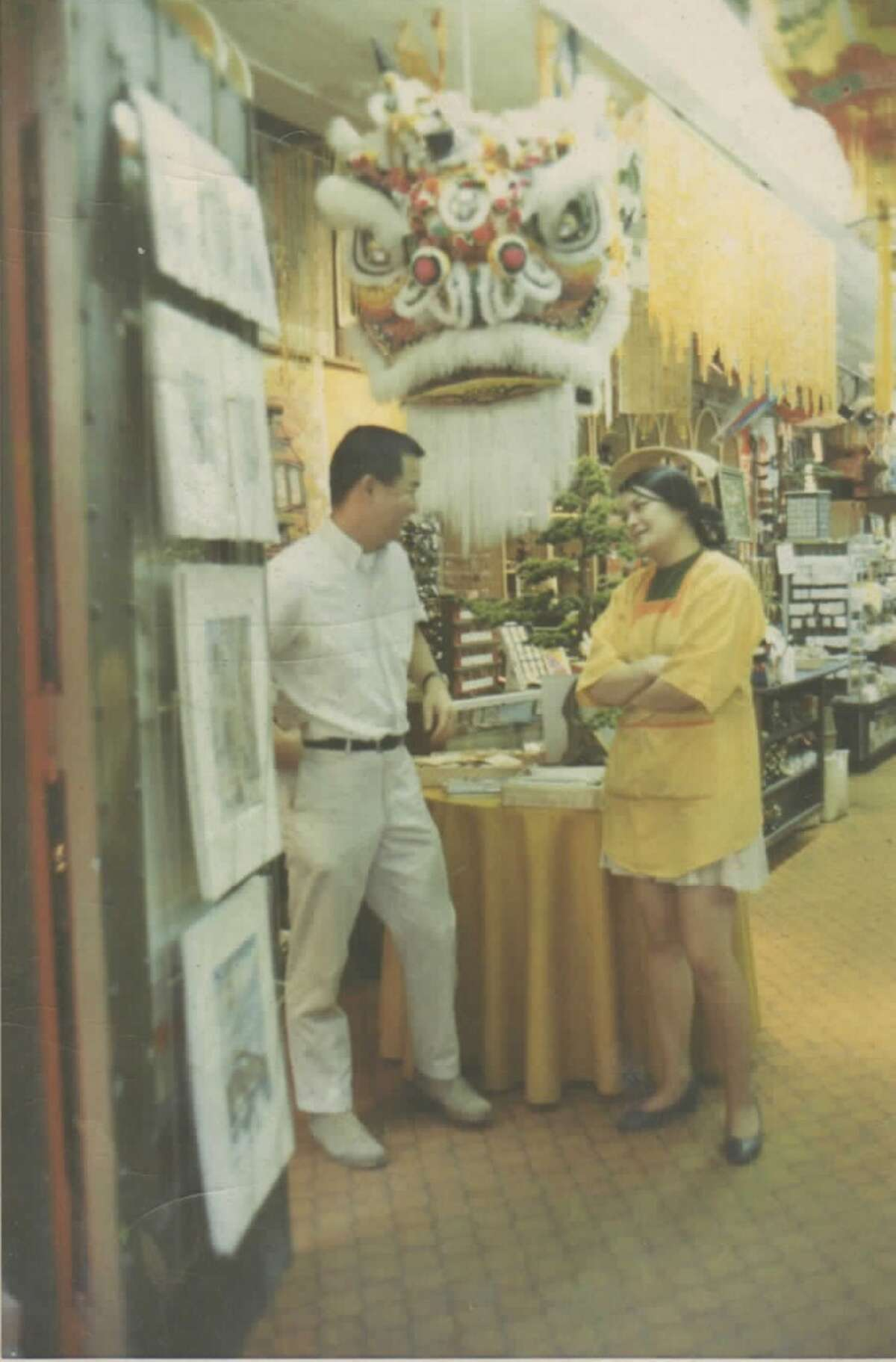 Tane Chan, right, with her husband, Al Chan, at their first Chinatown store, a gift shop called Yum Yum that opened in 1968.
