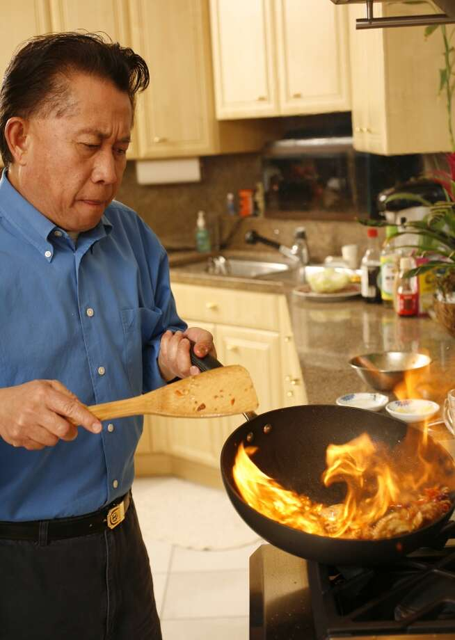 Martin Yan, a long-time friend of Chan, shows off his wok prowess. Photo: Craig Lee, SFC