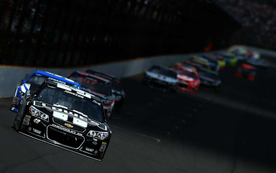 Jimmie Johnson leads a pack of cars at the Brickyard in Indianapolis on Saturday. He finished second. Photo: Patrick Smith, Getty Images