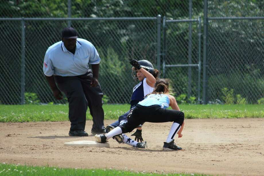 Westport's Sophia Alfero slides into second base during a 14-7 win over Enfield in Newington on Sunday in the winner's bracket final of the 10-11 Little League state tournament. Photo: Contributed Photo
