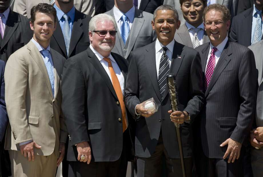 President Barack Obama holds an a autographed bat and ball during a ceremony on the South Lawn of the White House in Washington, Monday, July 29, 2013, where he honored the 2012 World Series Champion San Francisco Giants baseball team Photo: Carolyn Kaster, Associated Press