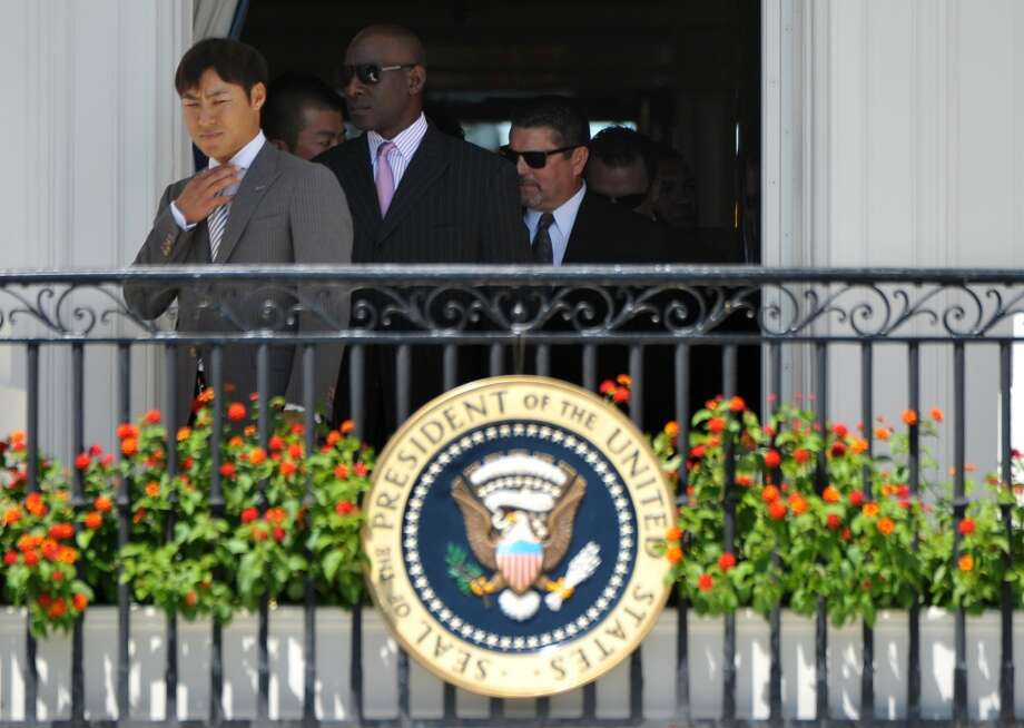 San Francisco Giants infielder Kensuke Tanaka (L) arrives for an event in honor of 2012 World Series champions the San Francisco Giants on the South Lawn. Photo: MANDEL NGAN, AFP/Getty Images