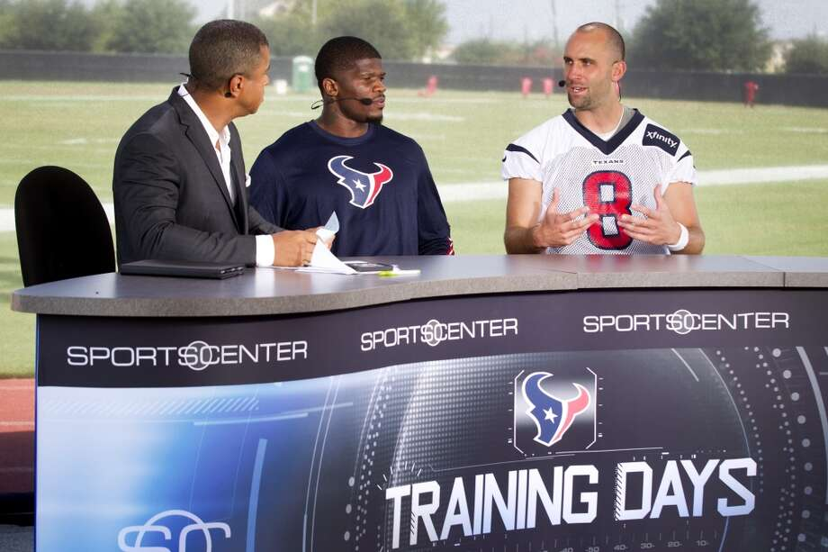 ESPN anchor Stan Stan Verrett, left, interviews wide receiver Andre Johnson and quarterback Matt Schaub during training camp on Monday at the Methodist Training Center. ESPN featured the Texans training camp during Monday's broadcasts. Photo: Brett Coomer, Chronicle
