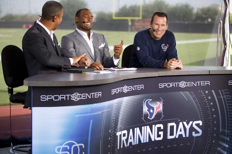 Head coach Gary Kubiak shares a laugh with ESPN broadcasters Stan Vertett, left, and Darren Woodson.