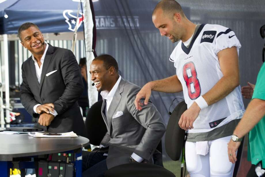 ESPN broadcasters Stan Verrett, left, and Darren Woodson prepare to interview quarterback Matt Schaub. Photo: Brett Coomer, Chronicle
