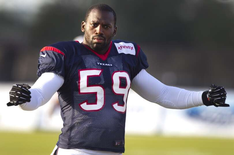 Outside linebacker Whitney Mercilus warms up before practice.