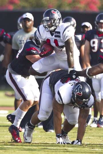 Running back Cierre Wood (41) tries to leap over guard Brandon Brooks (79).