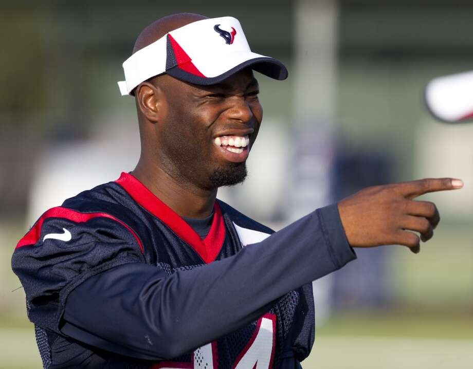 Cornerback Johnathan Joseph laughs while watching practice. Photo: Brett Coomer, Chronicle