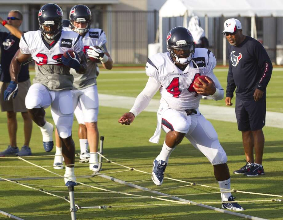 Fullback Greg Jones (33) and running back Ben Tate (44) run through a drill. Photo: Brett Coomer, Chronicle