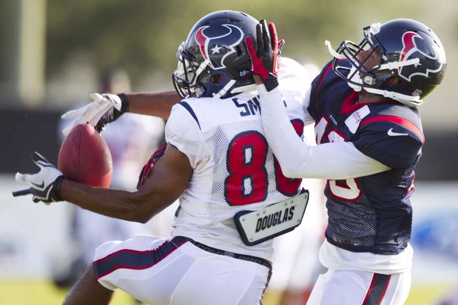 Cornerback Elbert Mack (43) breaks up a pass intended for Texans wide receiver Michael Smith (86). Photo: Brett Coomer, Chronicle