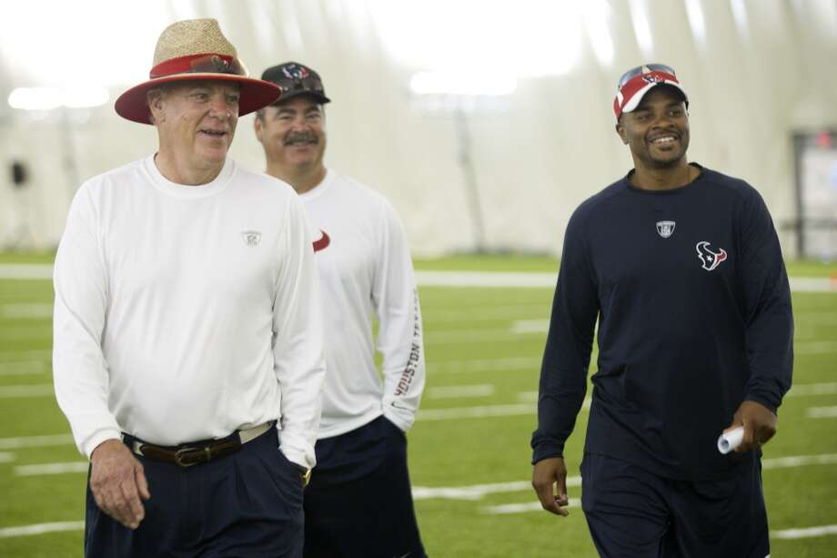 Owner Bob McNair, left, walks off the field with Cal McNair, Texans COO, and general manager Rick Smith. Photo: Brett Coomer, Chronicle