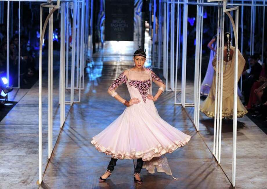 A model  presents a creation by Indian designer Tarun Tahiliani during the Grand Finale of Indian Bridal Fashion Week in New Delhi on July 28, 2013. AFP PHOTO/ SAJJAD HUSSAIN        (Photo credit should read SAJJAD HUSSAIN/AFP/Getty Images) Photo: SAJJAD HUSSAIN, AFP/Getty Images / 2013 AFP