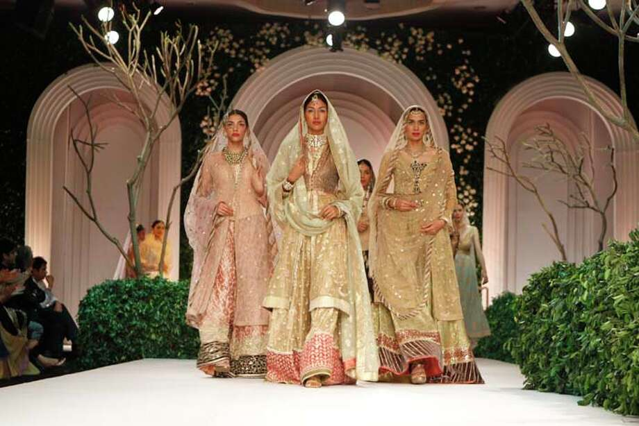 NEW DELHI, INDIA - JULY 24: Models show a creation by Meera Muzaffar Ali during the Indian Bridal Fashion Week held at The Grand on July 24, 2013 in New Delhi, India.  Meera Ali showcased an exotic Awadh inspired couture collection.(Photo by Waseem Gashroo/Hindustan Times via Getty Images) Photo: Hindustan Times, Hindustan Times Via Getty Images / 2013 Hindustan Times