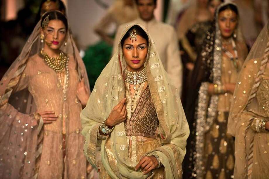 Models present creations by Meera Muzaffar Ali during the Indian Bridal Fashion Week in New Delhi July 24, 2013. The Indian Bridal Fashion Week 2013 is being held at The Grand in New Delhi from July 23-28. AFP PHOTO/ Prakash SINGH        (Photo credit should read PRAKASH SINGH/AFP/Getty Images) Photo: PRAKASH SINGH, AFP/Getty Images / 2013 AFP
