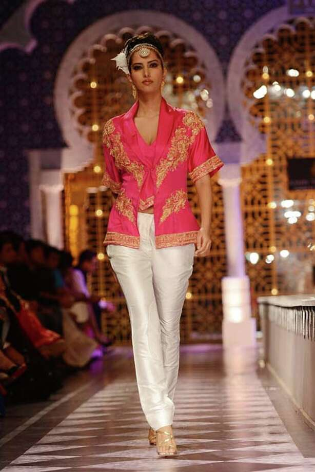 MUMBAI, INDIA  JULY 26: A modal walks the ramp for Raghavendra Rathore at Aamby Valley India Bridal Fashion Week 2013.(Photo by Ramesh Sharma/India Today Group/Getty Images) Photo: The India Today Group, India Today Group/Getty Images / Living Media India Limited