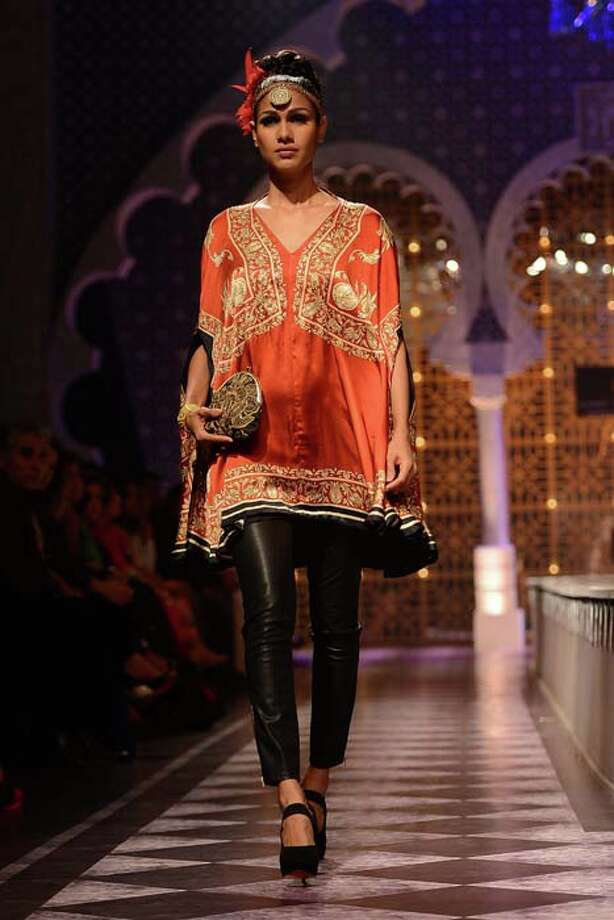 MUMBAI, INDIA  JULY 26: A modal walks the ramp for Raghavendra Rathore at Aamby Valley India Bridal Fashion Week 2013.(Photo by Ramesh Sharma/India Today Group/Getty Images) Photo: The India Today Group, India Today Group/Getty Images / Living Media India Limited