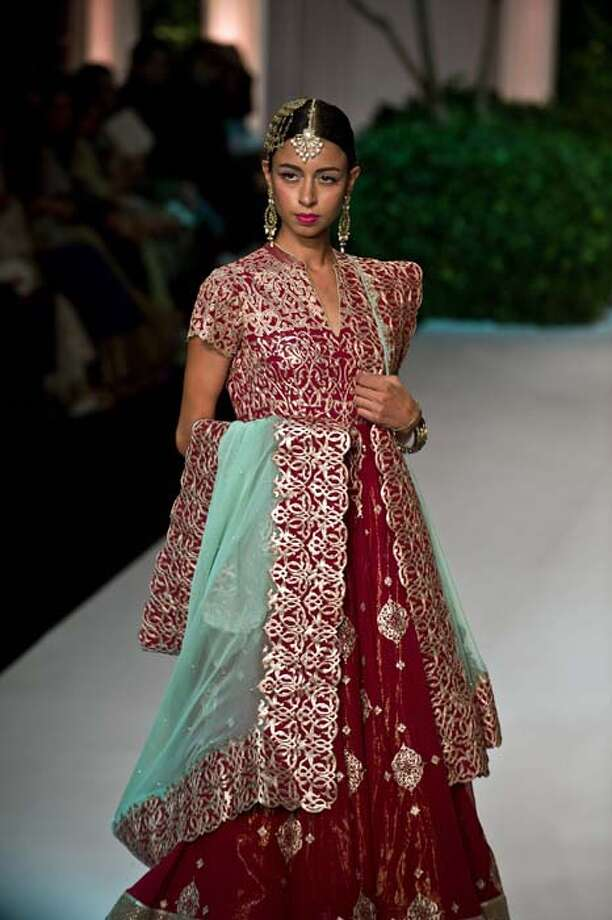 A model shows a creation by Meera Muzaffar Ali during the Indian Bridal Fashion Week in New Delhi July 24, 2013. The Indian Bridal Fashion Week 2013 is being held at The Grand in New Delhi from July 23-28. AFP PHOTO/ Prakash SINGH        (Photo credit should read PRAKASH SINGH/AFP/Getty Images) Photo: PRAKASH SINGH, AFP/Getty Images / 2013 AFP