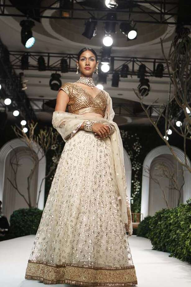NEW DELHI, INDIA - JULY 24: A model shows a creation by Meera Muzaffar Ali during the Indian Bridal Fashion Week held at The Grand on July 24, 2013 in New Delhi, India.  Meera Ali showcased an exotic Awadh inspired couture collection.(Photo by Waseem Gashroo/Hindustan Times via Getty Images) Photo: Hindustan Times, Hindustan Times Via Getty Images / 2013 Hindustan Times