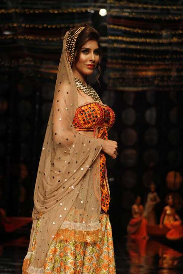 NEW DELHI, INDIA - JULY 24: Bollywood actor Sophie Choudry walked on ramp for Indian fashion designer Rina Dhaka during the Indian Bridal Fashion Week held at The Grand on July 24, 2013 in New Delhi, India. (Photo by Waseem Gashroo/Hindustan Times via Getty Images) Photo: Hindustan Times, Hindustan Times Via Getty Images / 2013 Hindustan Times