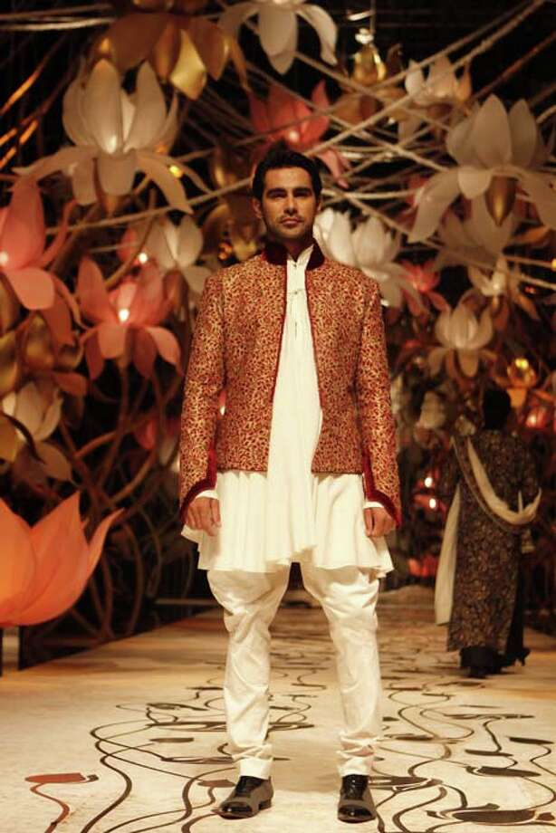 NEW DELHI, INDIA - JULY 26: A model shows a creation by Indian fashion designer Rohit Bal during the Indian Bridal Fashion Week 2013 held at The Grand on July 26, 2013 in New Delhi, India. (Photo by Waseem Gashroo/Hindustan Times via Getty Images) Photo: Hindustan Times, Hindustan Times Via Getty Images / 2013 Hindustan Times