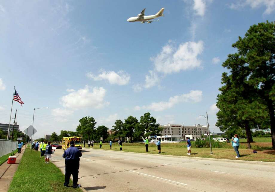 United Airlines employees and Union members line the sidewalk on JFK Blvd on Monday, July 29, 2013, in Houston. Over 100 protestors came out to protest the airlines plans to outsource work. Photo: J. Patric Schneider, For The Chronicle / © 2013 Houston Chronicle