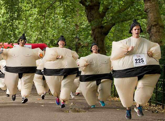 Tons of fun: While a Guinness Record for most people running in inflatable sumo suits exists, the racers   in the annual 5k charity Sumo Run at Battesea Park, London, were not trying to break it   this year. The satisfaction of   competing in fat suits and diapers was reward enough. Photo: Leon Neal, AFP/Getty Images