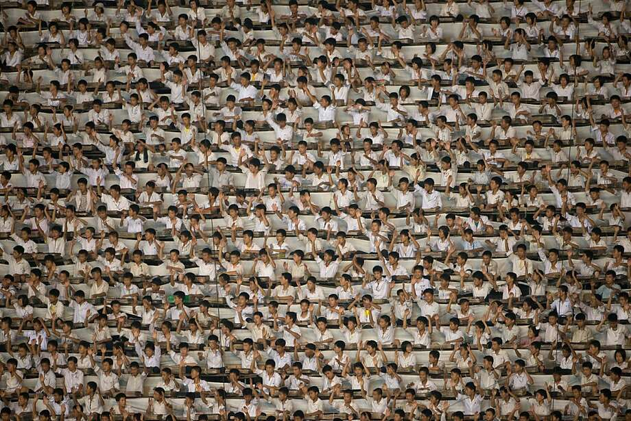 "Synchronized socialism: Everyone is a performer at the ""Arrirang Festival mass games display"" in Pyongyang's Rungnado May Day Stadium. Some 100,000 people created a ""synchronized socialist-realist spectacular"" in a ""highly politicized"" 90-minute display of gymnastics, dance, acrobatics and theater. Photo: Ed Jones, AFP/Getty Images"
