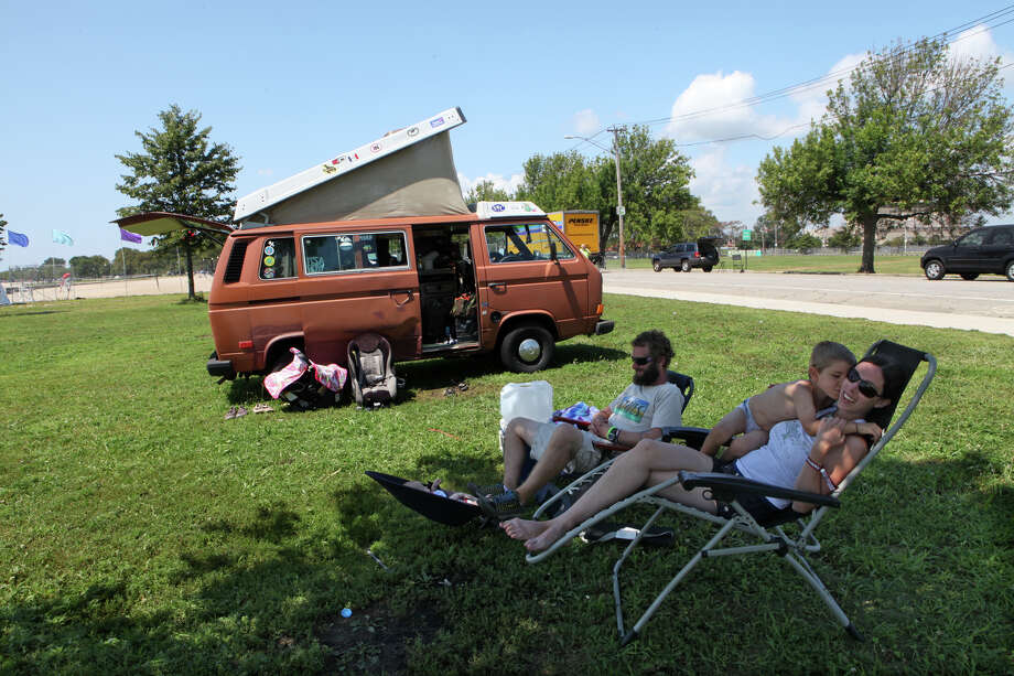 After a weekend at the Vibes, Casey Zawicki, left, of Cape Cod,  and Lindsay Cook, and their two children, Orin, 5, and Ilea, 9 weeks, wait for auto help by their broken down van in Seaside Park in Bridgeport on Monday, July 29, 2013. Photo: BK Angeletti, B.K. Angeletti / Connecticut Post freelance B.K. Angeletti