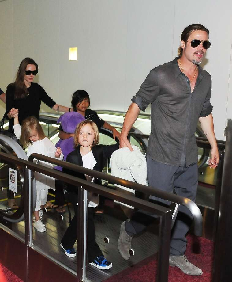 Brad Pitt, Angelina Jolie and their children Knox Jolie-Pitt, Pax Jolie-Pitt and Vivienne Jolie-Pitt arrive at Tokyo International Airport  on July 28, 2013 in Tokyo, Japan.  (Photo by Jun Sato/WireImage) Photo: Jun Sato, WireImage