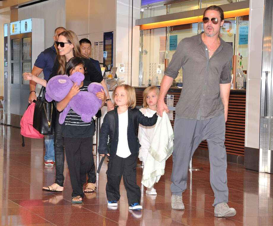Brad Pitt, Angelina Jolie and their children Pax, Knox and Vivienne arrive at Tokyo International Airport  on July 28, 2013 in Tokyo, Japan. (Photo by Jun Sato/WireImage) Photo: Jun Sato, WireImage