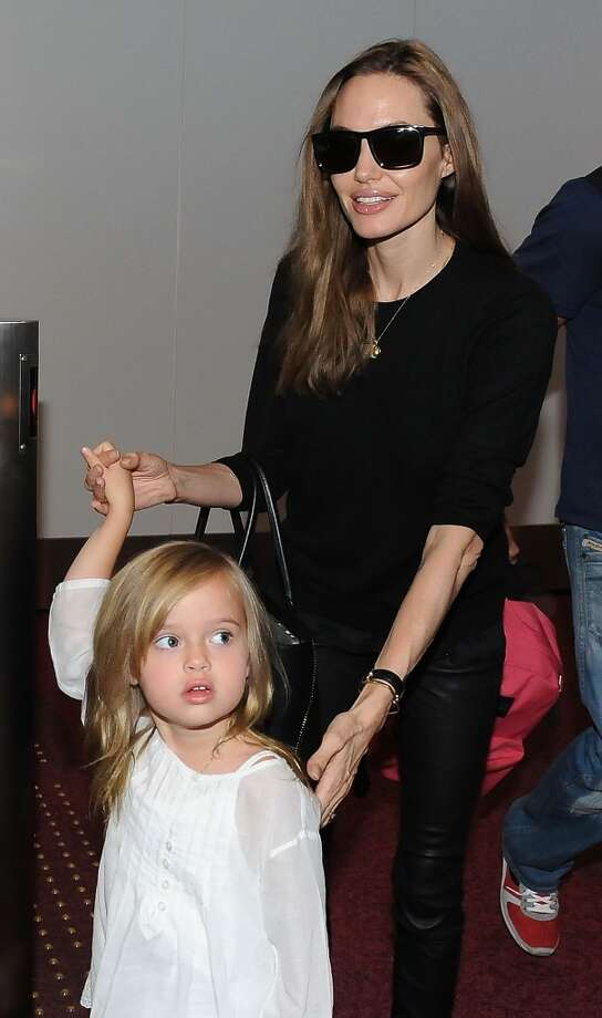 Angelina Jolie and Vivienne Jolie-Pitt arrive at Tokyo International Airport  on July 28, 2013 in Tokyo, Japan.  (Photo by Jun Sato/WireImage) Photo: Jun Sato, WireImage