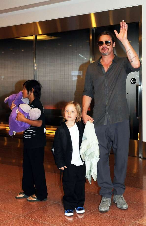 Brad Pitt, Pax Jolie-Pitt and Knox Jolie-Pitt arrive at Tokyo International Airport  on July 28, 2013 in Tokyo, Japan.  (Photo by Jun Sato/WireImage) Photo: Jun Sato, WireImage