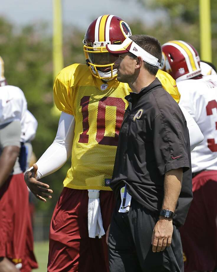 Robert Griffin III talks to quarterbacks coach Matt LaFleur at training camp in Richmond, Va. Photo: Steve Helber, Associated Press