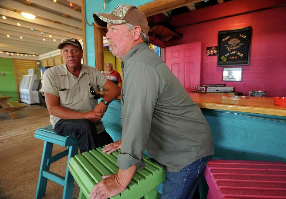 Alan Moore, left, and Sid Pulliam, right, who were at the Fanta Sea BBQ and Grill this week, lost their homes in Ike and have yet to rebuild. Both were talking about the old Bolivar verses the new Boliver.  His home across the street survived Hurricane Ike. The pre Hurricane Ike Bolivar Peninsula was your extra older stuff being transported to a beach cabin your grandpa may have built in the '50s that might get used once or twice a year. But after Hurricane Ike rolled in  five years ago, washing away much of the beach community's rustic charm, not much has been the same since. The new emerging Bolivar is slick and spruced up with upscale beach houses in pastel colors.  People still remember the old Mecom's Pier and other places that no longer exist that now are being replaced with RV grounds, more eating establishments, and new towering beach front homes.  Dave Ryan/The Enterprise Photo: Dave Ryan