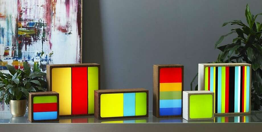 """San Francisco designer Romy Randev blends glass, colorful LED lights and bamboo to create his mood lights, which he labels """"functional art."""" Photo: Looma Lites"""