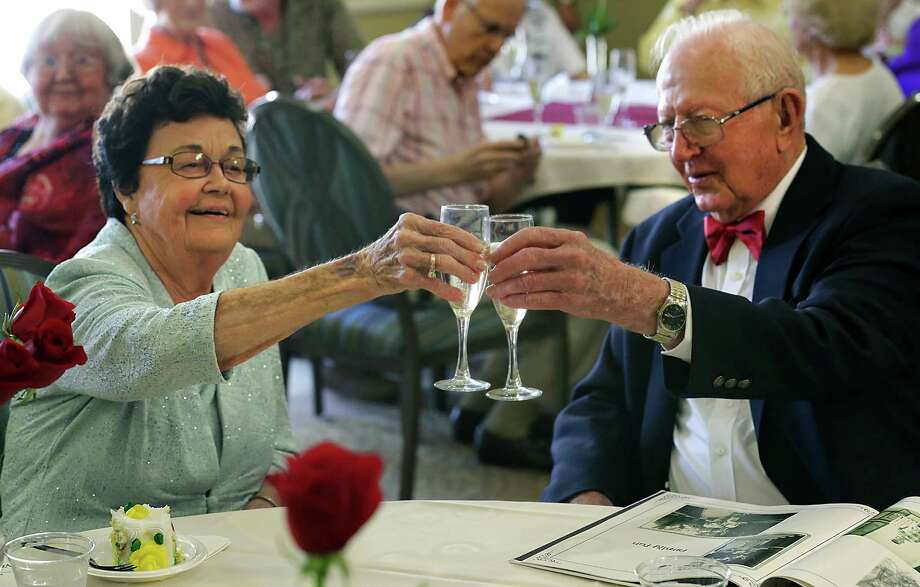 Harold and Thelma Farrell toast, celebrating their 75th wedding anniversary at Franklin Park Sonterra assisted living center. Photo: Bob Owen, San Antonio Express-News / © 2012 San Antonio Express-News